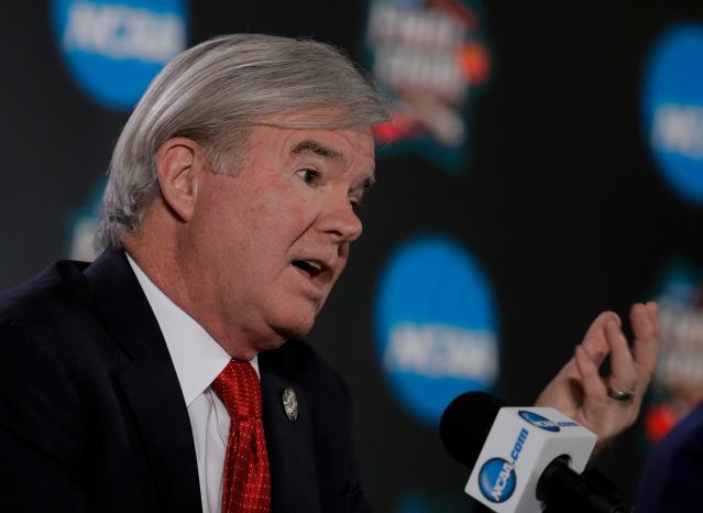 "FILE - In this March 29, 2018, file photo, NCAA President Mark Emmert speaks during a news conference at the Final Four NCAA college basketball tournament in San Antonio. College basketball spent an entire season operating amid a federal corruption investigation that magnified long-simmering problems within the sport, from unethical agent conduct to concerns over the ""one-and-done"" model. On Wednesday morning, April 25, 2018, the commission headed by former Secretary of State Condoleezza Rice will present its proposed reforms to university presidents of the NCAA Board of Governors and the Division I Board of Directors at the NCAA headquarters in Indianapolis. I expect the proposals will be strong, Emmert recently told The Associated Press. Theyll certainly break with the status quo. Thats their charge and their mission. Thats what we need. (AP Photo/David J. Phillip, File)"