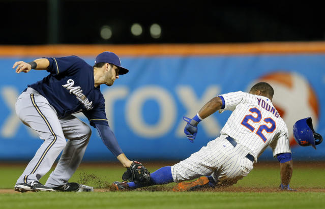 Milwaukee Brewers shortstop Jeff Bianchi (14) places the tag on the leg of New York Mets left fielder Eric Young Jr. (22) stealing second base in the first inning as it appeared Young was out, but he was called safe on the play during a baseball game at Citi Field in New York, Thursday, Sept. 26, 2013. (AP Photo/Paul J. Bereswill)