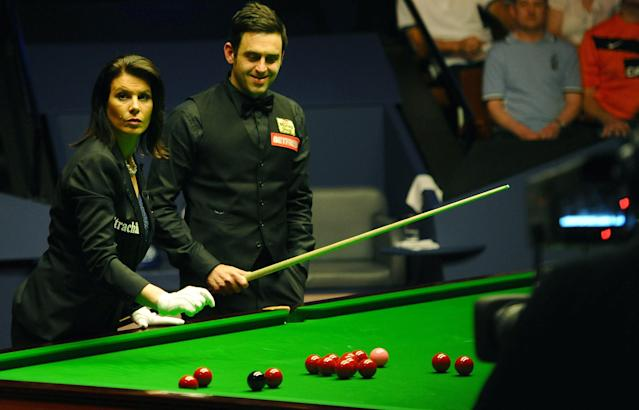 Ronnie O'Sullivan of England (R) and referee Michaela Tabb reposition the balls after a foul during the second session of the World Championship Snooker final against Ali Carter of England at the Crucible Theatre in Sheffield, on May 7, 2012. AFP PHOTO/PAUL ELLISPAUL ELLIS/AFP/GettyImages