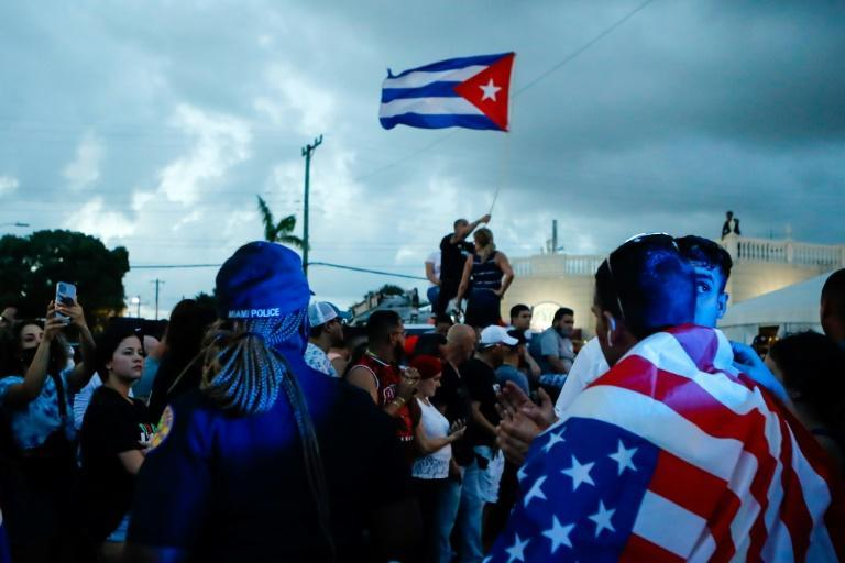 Cuban Americans demonstrate in Miami's Little Havana neighborhood, waving US and Cuban flags in support of protesters in Cuba