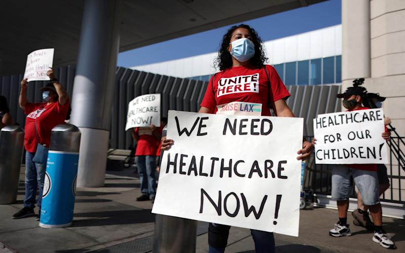 Many in America disapprove of how President Trump has handled the coronavirus pandemic, including laid-off airport workers at LAX International Airport - LUCY NICHOLSON /Reuters