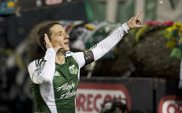 Portland Timbers midfielder Will Johnson (4) signals to the crowd after he scored on free kick against Seattle Sounders FC goalkeeper Michael Gspurning (1) in Game 2 of the Western Conference semifinals of the MLS Cup at Jeld-Wen Field in Portland Thursday Nov. 7, 2013. (AP Photo/The Oregonian, Randy L. Rasmussen)