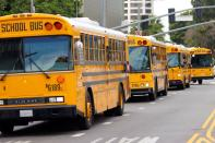 FILE PHOTO: School bus drivers take part in caravan to demand proper funding for schools to support distant learning and a safe return to classes, in Los Angeles
