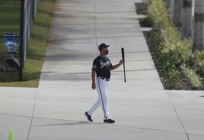 Atlanta Braves Hall of Famer Chipper Jones leaves the batting cages twirling his bat after a morning session of batting practice during baseball spring training, Wednesday, Feb. 24, 2021, in North Port, Fla. (Curtis Compton/Atlanta Journal-Constitution via AP)