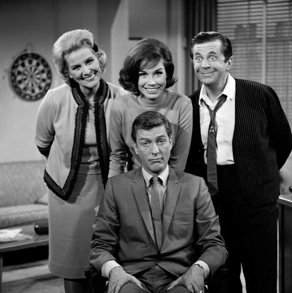 "LOS ANGELES - JANUARY 1: ""THE DICK VAN DYKE SHOW"" are (Standing, left to right) Rose Marie, Mary Tyler Moore, Morey Amsterdam; (seated) Dick Van Dyke. Image dated 1961. (Photo by CBS via Getty Images)"