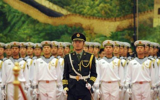 Members of the Chinese military honor guard stand in formation