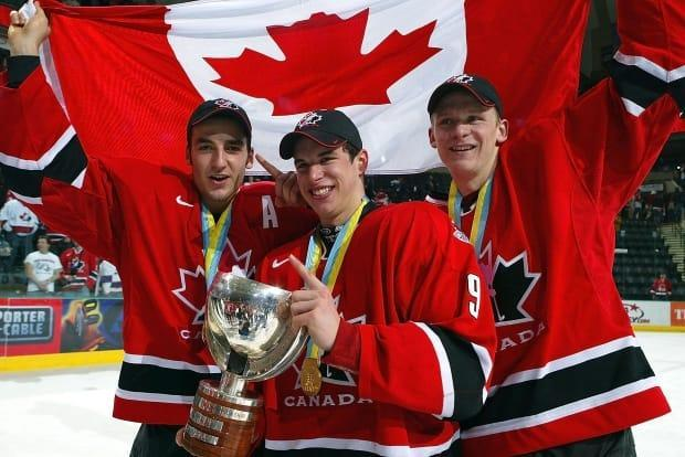 Patrice Bergeron, left, Sidney Crosby, centre, and Corey Perry of Team Canada celebrate their gold-medal win after beating Team Russia at the World Juniors on Jan. 4, 2005, in Grand Forks, North Dakota. Canada defeated Russia 6-1.