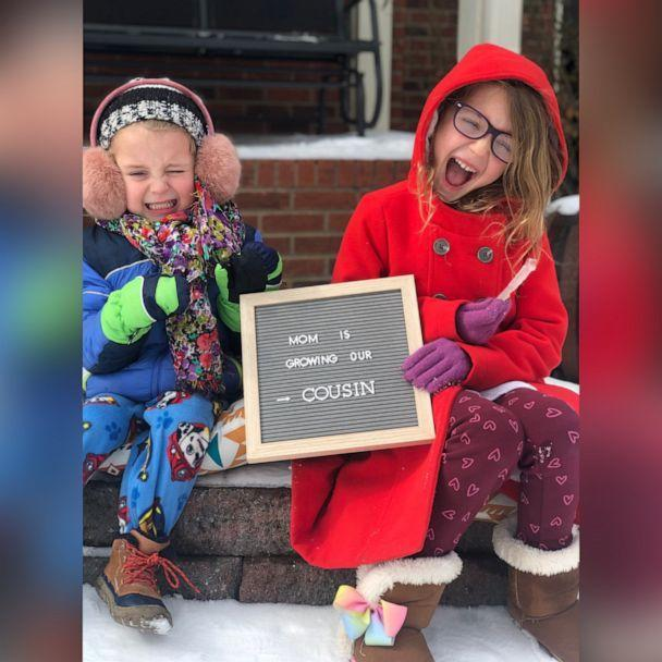PHOTO: Cathey Stoner's children, Samson and Ruthie, hold a sign announcing their mom's pregnancy, in an undated family photo. (Courtesy Sarah Sharp and Cathey Stoner)