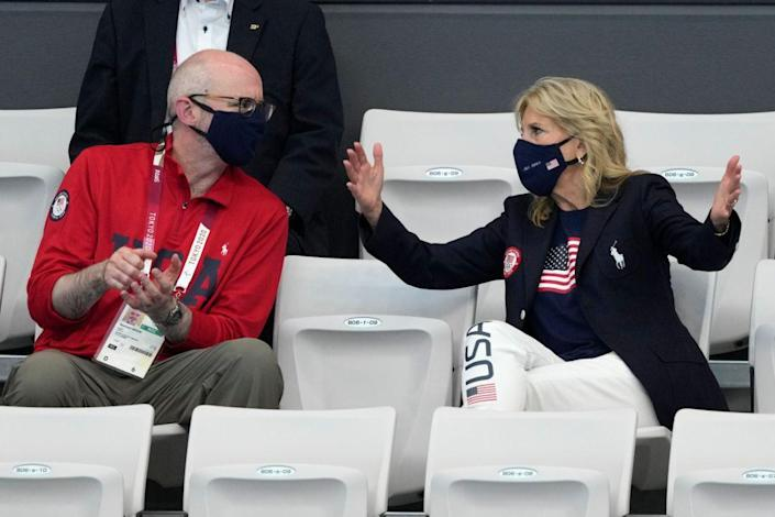 First Lady of the United States Jill Biden, right, gestures as she talks to Raymond Greene prior to the start of the swimming competition at the 2020 Summer Olympics, Saturday, July 24, 2021, in Tokyo, Japan. - Credit: AP