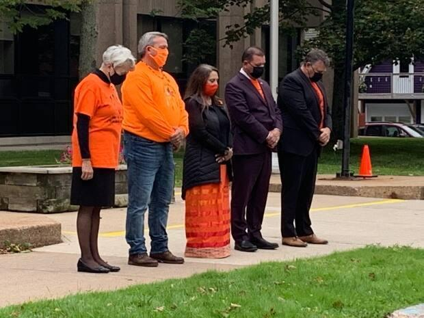 Members of the public joined Indigenous leaders for two minutes of silence Thursday at noon AT in Charlottetown. (Laura Meader/CBC - image credit)