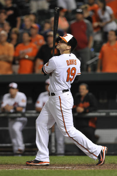 Baltimore Orioles Chris Davis follows through on a game winning RBI single against the Boston Red Sox in the 13th inning of a baseball game Thursday, June 13, 2013 in Baltimore. The Orioles won 5-4.(AP Photo/Gail Burton)