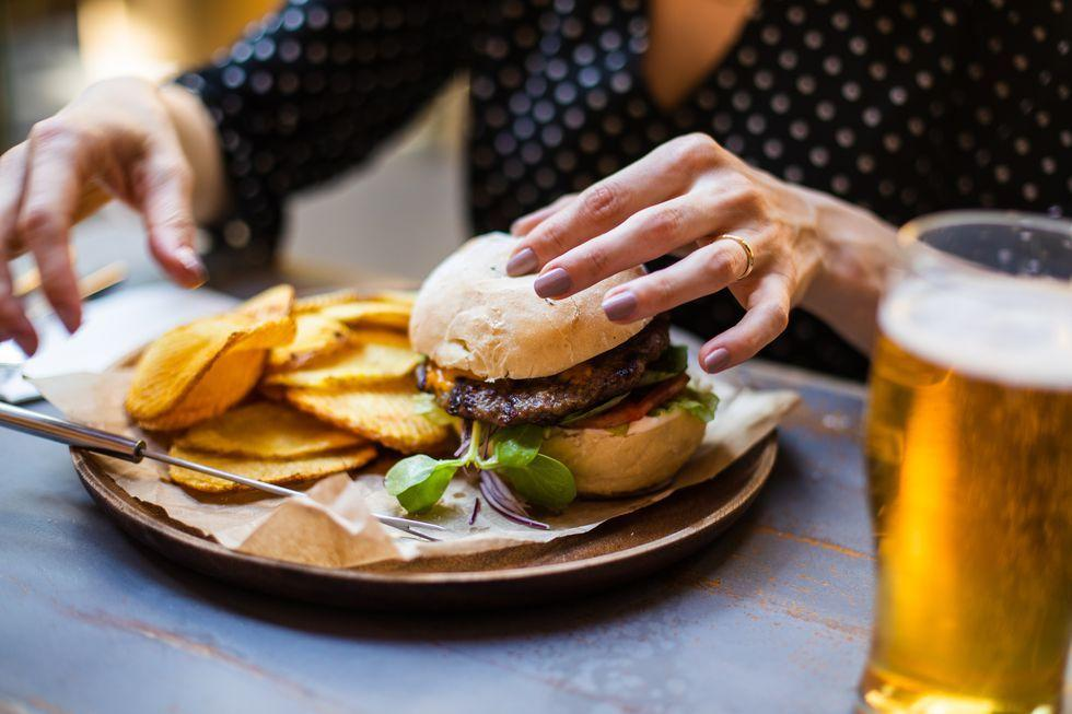 """<p>If you've hit the drive-thru for a high-fat meal and shortly after find yourself in extreme pain that doesn't dissipate, it could be a sign of a gallbladder attack, Hardeep Singh, M.D., a gastroenterologist at <a href=""""https://stjosephhospital.chsli.org/"""" target=""""_blank"""">St. Joseph Hospital</a>, tells Woman's Day. The gallbladder is a small pear-shaped sac that sits underneath your liver, and its main function is to store bile and pass it along to the small intestine, where fat gets digested. When the gallbladder becomes inflamed — usually due to gallstones blocking the duct that leads to the small intestine, thus causing bile to build up — it can lead to <a href=""""https://www.healthline.com/health/gallbladder-disease"""" target=""""_blank"""">gallbladder disease</a>.</p>"""