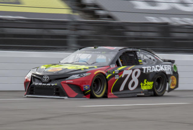 "<a class=""link rapid-noclick-resp"" href=""/nascar/sprint/drivers/380/"" data-ylk=""slk:Martin Truex Jr"">Martin Truex Jr</a>. drives during practice for the NASCAR Cup Series auto race at Martinsville Speedway in Martinsville, Va., Saturday, March 24, 2018. (AP Photo/Matt Bell)"