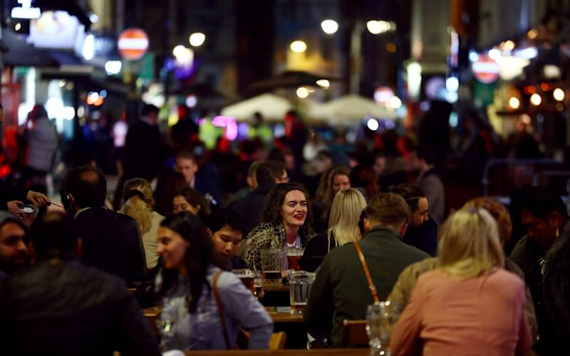 People sit at the tables outside restaurants in Soho, amid the outbreak of the coronavirus disease (COVID-19), in London, Britain, September 24, 2020 - Hannah McKay/Reuters