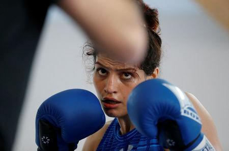 Iranian boxer Sadaf Khadem attends a training session in preparation to her first official boxing bout in Royan, France, April 11, 2019. REUTERS/Regis Duvignau