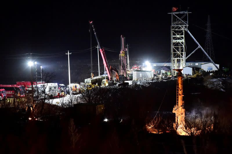 FILE PHOTO: Rescue teams work on saving workers trapped underground after an explosion at the gold mine under construction in Qixia