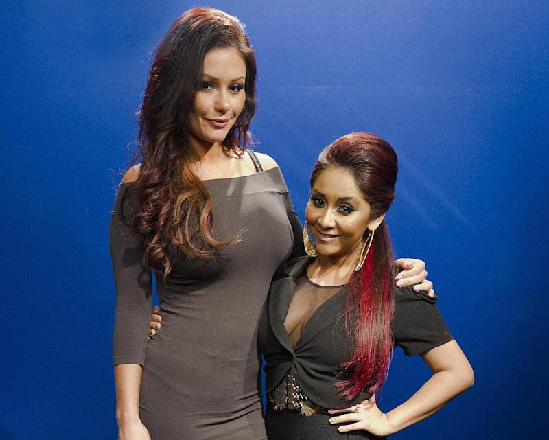 "FILE - This Feb. 1, 2012 file photo shows Jenni ""JWoww"" Farley, left, and Nicole ""Snooki"" Polizzi in New York. The mayor of Manchester Township in Ocean County tells the Asbury Park Press that the ""Jersey Shore"" spinoff ""Snooki & JWoww"" will start shooting there in the next few days. The Point Pleasant Beach Council in New Jersey had unanimously voted against 495 Productions' request to tape the ""Jersey Shore"" spinoff featuring Polizzi and Farley. Nearby Toms River also turned down the MTV reality series. ""Snooki & JWoww"" taped its first season in Jersey City. (AP Photo/Charles Sykes, file)"