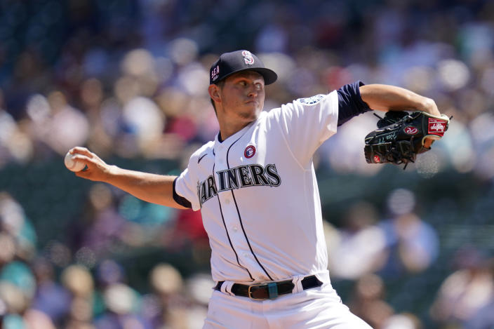 Seattle Mariners starting pitcher Chris Flexen throws against the Texas Rangers in the second inning of a baseball game Sunday, July 4, 2021, in Seattle. (AP Photo/Elaine Thompson)