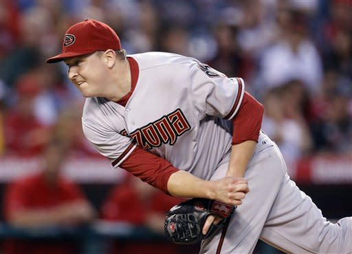 Arizona Diamondbacks starting pitcher Trevor Cahill throws against the Los Angeles Angels in the third inning of a baseball game in Anaheim, Calif., Friday, June 15, 2012. (AP Photo/Jae C. Hong)