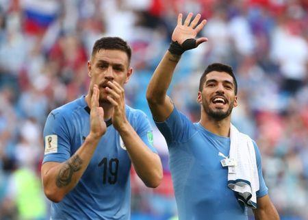 Soccer Football - World Cup - Group A - Uruguay vs Russia - Samara Arena, Samara, Russia - June 25, 2018 Uruguay's Sebastian Coates and Luis Suarez celebrate after the match REUTERS/Michael Dalder