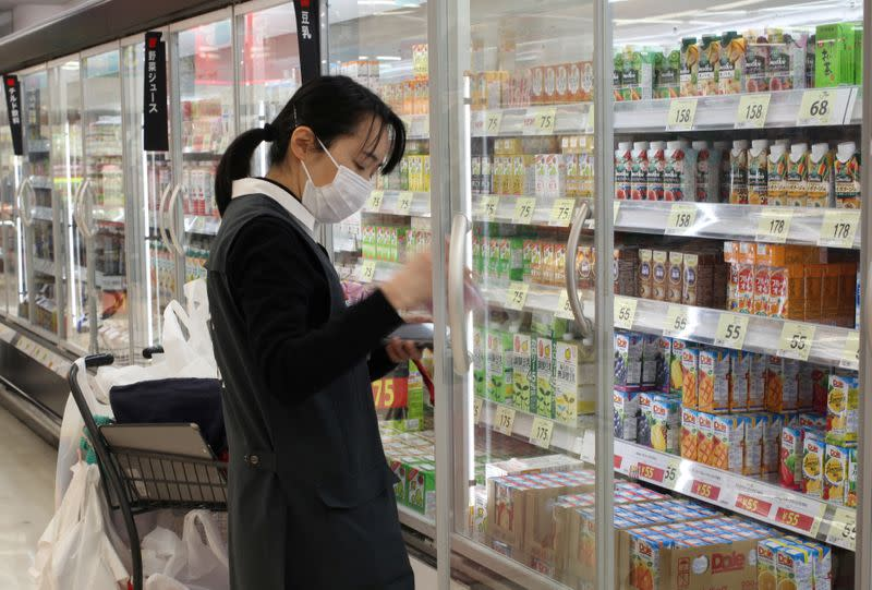 An employee picks out products to fulfil online orders at a Seiyu store in Tokyo