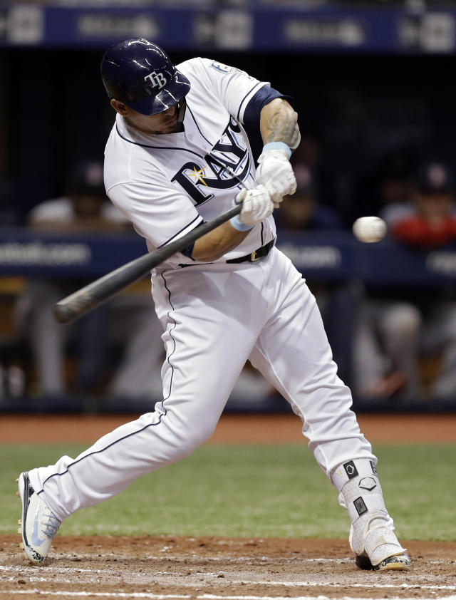 Tampa Bay Rays' Wilson Ramos connects for a two-run single off Boston Red Sox starting pitcher Rick Porcello during the first inning of a baseball game Thursday, May 24, 2018, in St. Petersburg, Fla. (AP Photo/Chris O'Meara)