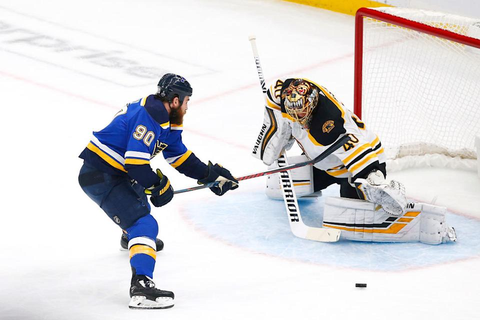 ST LOUIS, MISSOURI - JUNE 09:  Ryan O'Reilly #90 of the St. Louis Blues attempts a shot against Tuukka Rask #40 of the Boston Bruins during the first period in Game Six of the 2019 NHL Stanley Cup Final at Enterprise Center on June 09, 2019 in St Louis, Missouri. (Photo by Dilip Vishwanat/Getty Images)