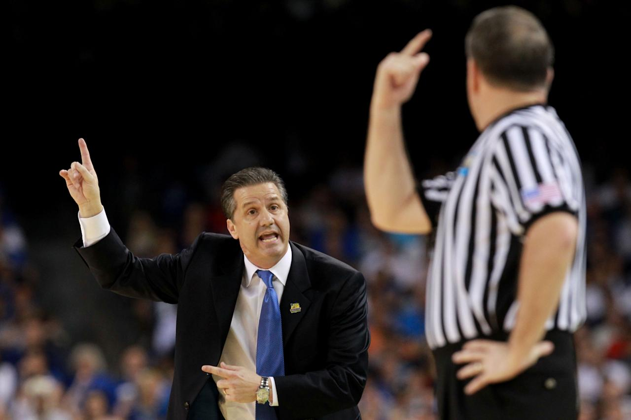 Head coach John Calipari of the Kentucky Wildcats reacts along with the referee in the first half against the Kansas Jayhawks in the National Championship Game of the 2012 NCAA Division I Men's Basketball Tournament at the Mercedes-Benz Superdome on April 2, 2012 in New Orleans, Louisiana. (Photo by Ronald Martinez/Getty Images)