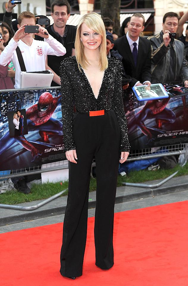 "The night prior to rocking his very-berry suit, Andrew's gal pal and <a target=""_blank"" href=""http://movies.yahoo.com/movie/the-amazing-spiderman/"">""Spider-Man""</a> co-star, Emma Stone, turned heads at the soon-to-be blockbuster's London debut in this Elie Saab jumpsuit, which featured crystal embellishments and a plunging neckline. What do you make of the 23-year-old's outfit? Hot or not? (6/18/2012)"