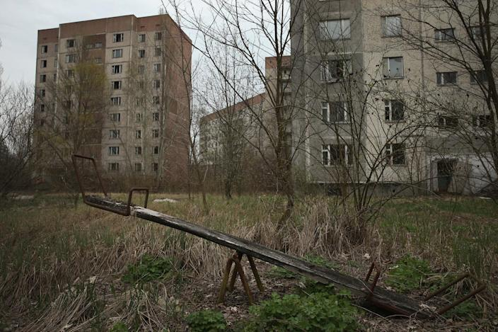 <p>A children's seesaw stands among former apartment buildings on (Getty Images) </p>
