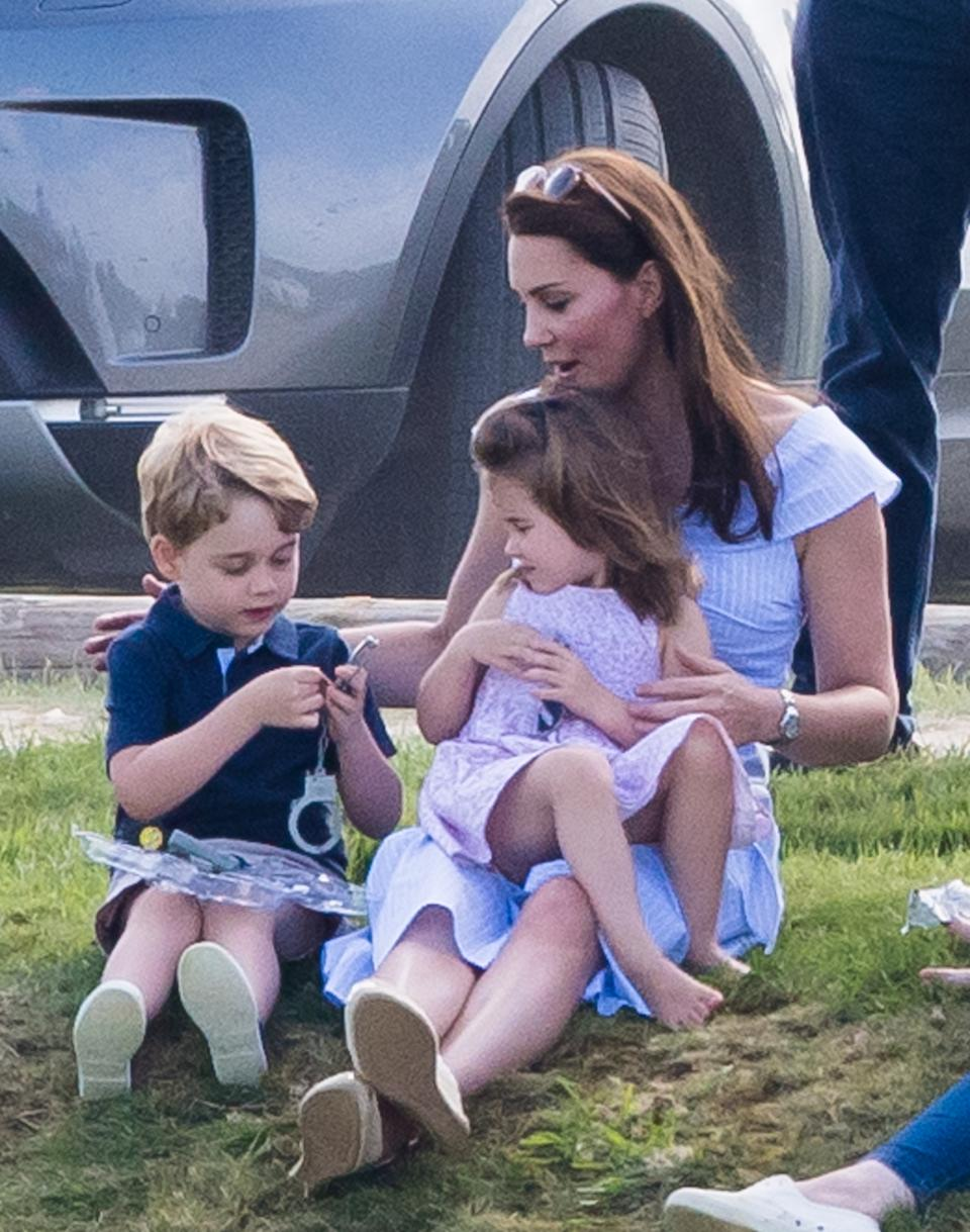 GLOUCESTER, ENGLAND - JUNE 10:  Catherine, Duchess of Cambridge, Prince George of Cambridge and Princess Charlotte of Cambridge attend the Maserati Royal Charity Polo Trophy at Beaufort Park on June 10, 2018 in Gloucester, England.  (Photo by Samir Hussein/WireImage)