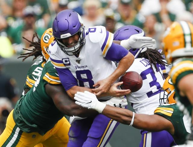 Minnesota Vikings' Kirk Cousins fumbles as he is hit during the first half of an NFL football game against the Green Bay Packers Sunday, Sept. 15, 2019, in Green Bay, Wis. The Packers recovered the fumble. (AP Photo/Matt Ludtke)