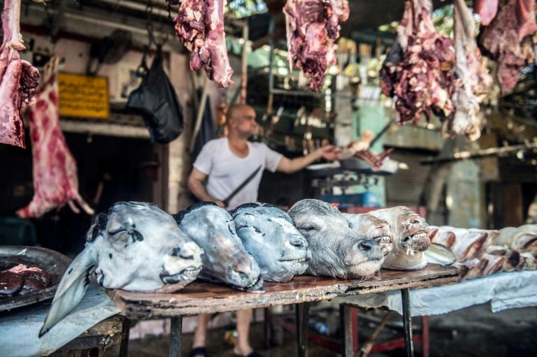Zinhum Abdelmoneem works at his butchery in Cairo on August 16, 2018, ahead of the annual Muslim Eid al-Adha holiday