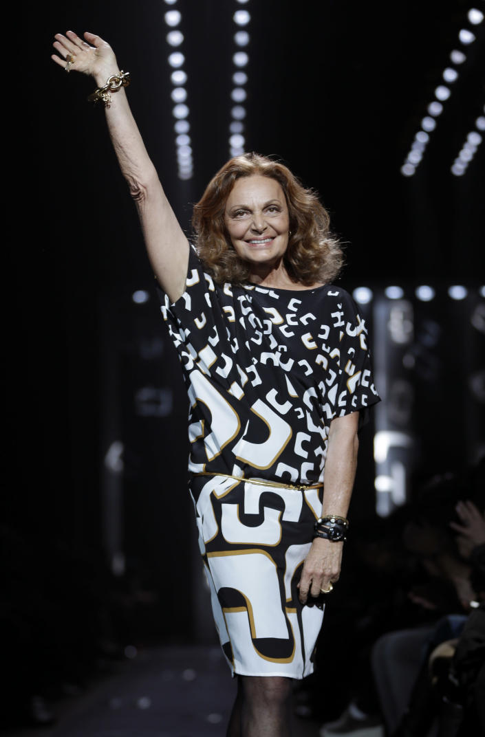 Diane von Furstenberg greets the crowd after showing her Fall 2013 collection during Fashion Week in New York, Sunday, Feb. 10, 2013. (AP Photo/Seth Wenig)