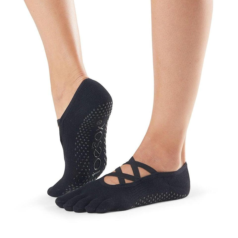 <p>It's important to wear socks with some grip, so you can confidently move between poses without worrying about slipping. Snyder loves these <span>ToeSox Full Toe Elle Grip Socks</span> ($20) because they're so soft.</p>