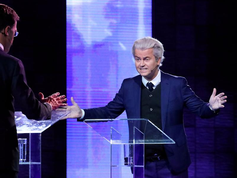 Dutch far-right politician Geert Wilders of the PVV party and Dutch Prime Minister Mark Rutte (L) of the VVD Liberal party take part in the