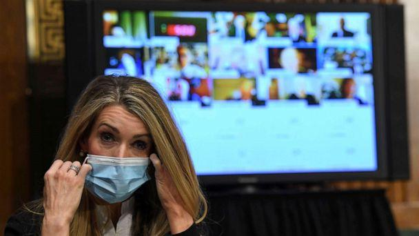 PHOTO: Senator Kelly Loeffler removes her mask before the Senate Committee for Health, Education, Labor, and Pensions hearing on the coronavirus disease (COVID-19), in Washington, May 12, 2020. (Toni L. Sandys/Reuters)