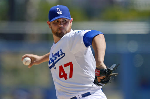 Los Angeles Dodgers starting pitcher Ricky Nolasco throws to the plate during the first inning of their baseball game against the Chicago Cubs, Wednesday, Aug. 28, 2013, in Los Angeles. (AP Photo/Mark J. Terrill)