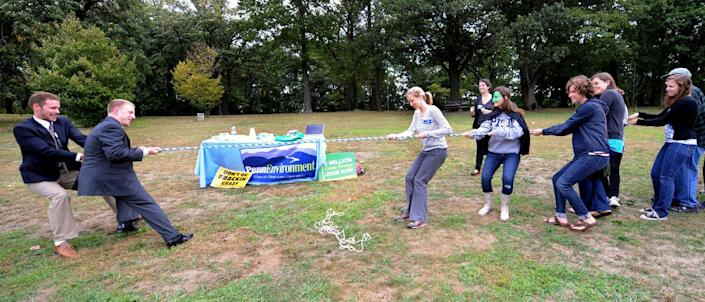 """Local groups from Pittsburgh take part in a Frackdown Smackdown tug-of-war between college students representing the """"gas industry"""" and Pennsylvania citizens during a global Frackdown Day Schenley Park in Pittsburgh, Saturday, Sept. 22, 2012. (AP Photo/John Heller)"""
