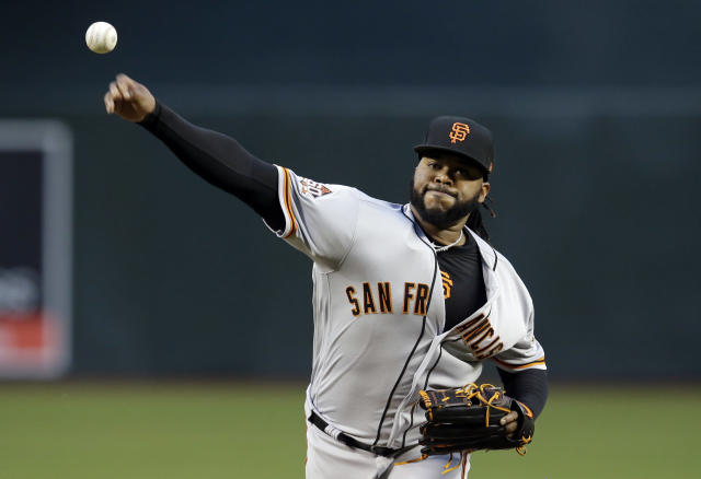 San Francisco Giants starting pitcher Johnny Cueto throws in the first inning during a baseball game against the Arizona Diamondbacks, Tuesday, April 17, 2018, in Phoenix. (AP Photo/Rick Scuteri)