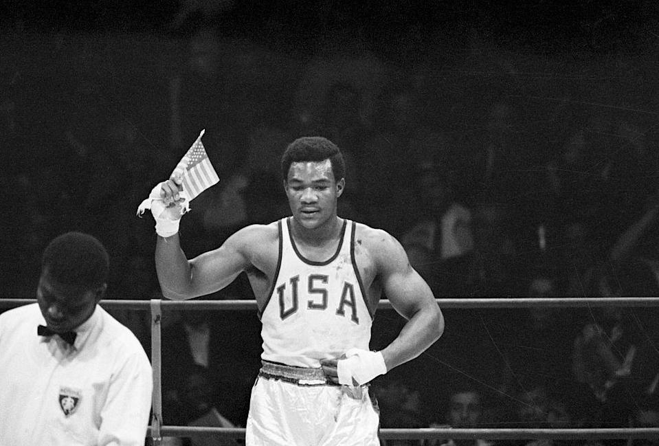 """<p>After two athletes performed the Black Power salute during the US anthem, George Foreman inadvertently made a statement by waving a small American flag following his heavyweight boxing win. Even though Foreman later commented that he simply wanted to identify his home country, <a href=""""https://theundefeated.com/features/george-foreman-american-flag-john-carlos-tommie-smith-1968-olympics/"""" rel=""""nofollow noopener"""" target=""""_blank"""" data-ylk=""""slk:critics accused him of being a &quot;race traitor"""" class=""""link rapid-noclick-resp"""">critics accused him of being a """"race traitor</a>"""" at the time.</p>"""