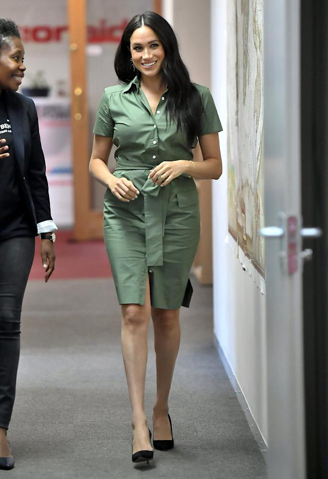 """Meghan continued her solo outing in Johannesburg with <a href=""""https://people.com/royals/meghan-markle-continues-africa-tour-with-visit-to-a-girls-club-to-tackle-sexual-violence-in-schools/"""" target=""""_blank"""">a visit to a local school</a> to learn how a local charity is working to raise awareness and end sexual violence in schools. For her visit, Meghan wore a green utility-style belted shirtdress from Room 502 and black pumps.  <strong>Get the Look!</strong>  Daily Ritual Daily Ritual Women's Tencel Long-Sleeve Utility Dress, $39; <a href=""""https://www.amazon.com/Daily-Ritual-Womens-Long-Sleeve-Utility/dp/B07J2VYKJM/ref=as_li_ss_tl?dchild=1&keywords=women+green+utility+dress&qid=1569958190&sr=8-1&linkCode=ll1&tag=poamzfmeghanmarkleafricatourkphillips1019-20&linkId=5c3097847a753972d1eda09d19a87e81&language=en_US"""" target=""""_blank"""">amazon.com</a>  Sharagano Roll Sleeve Double Breasted Trench Dress, $36.97 (orig. $89); <a href=""""https://www.pntrs.com/t/8-10134-131940-120793?sid=PEO%2CShopping%3AEveryOutfitMeghanMarkleHasWornonHerRoyalTourinAfrica%28andHowtoGetHerLook%21%29%2Ckamiphillips2%2CUnc%2CGal%2C7319077%2C201910%2CI&url=https%3A%2F%2Fwww.nordstromrack.com%2Fshop%2Fproduct%2F2975494%2Fsharagano-roll-sleeve-double-breasted-trench-dress"""" target=""""_blank"""" rel=""""nofollow"""">nordstromrack.com</a>  Joie Jadallah Shirtdress, $89.10 (orig. $198); <a href=""""https://click.linksynergy.com/deeplink?id=93xLBvPhAeE&mid=1237&murl=https%3A%2F%2Fshop.nordstrom.com%2Fs%2Fjoie-jadallah-shirtdress%2F5462713&u1=PEO%2CShopping%3AEveryOutfitMeghanMarkleHasWornonHerRoyalTourinAfrica%28andHowtoGetHerLook%21%29%2Ckamiphillips2%2CUnc%2CGal%2C7319077%2C201910%2CI"""" target=""""_blank"""" rel=""""nofollow"""">nordstrom.com</a>  Topshop Utility Shirtdress, $75; <a href=""""https://click.linksynergy.com/deeplink?id=93xLBvPhAeE&mid=1237&murl=https%3A%2F%2Fshop.nordstrom.com%2Fs%2Ftopshop-utility-shirtdress%2F5204283&u1=PEO%2CShopping%3AEveryOutfitMeghanMarkleHasWornonHerRoyalTourinAfrica%28andHowtoGetHerLook%21%29%2Ckami"""