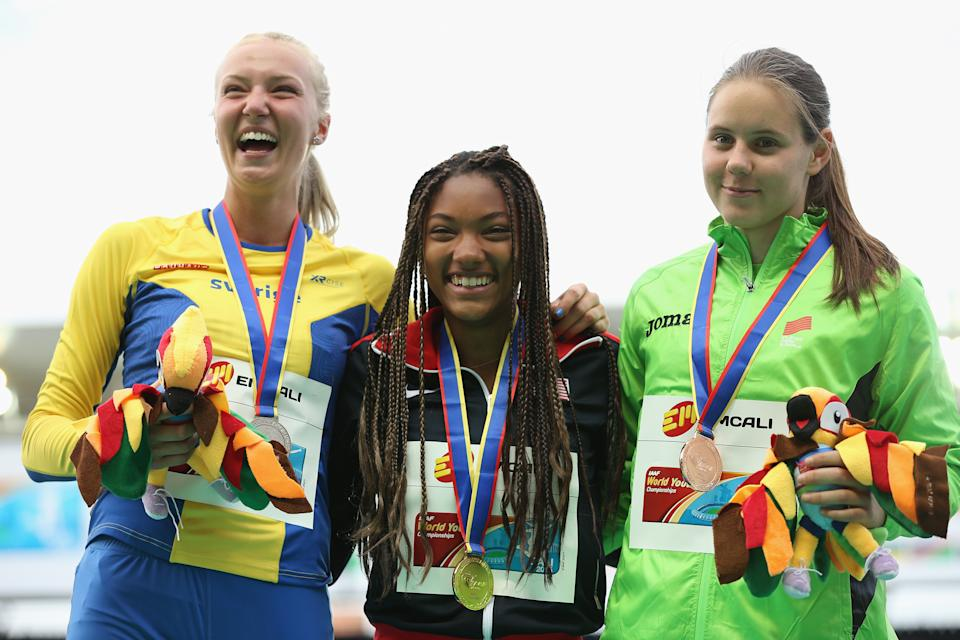 <p>Tara Davis of the USA, gold medal, Kaiza Karlen of Sweden, silver medal, and Maja Bedrac of Slovenia, bronze medal, celebrate on the podium after the Girls Long Jump Final on day five of the IAAF World Youth Championships, Cali 2015 on July 19, 2015 at the Pascual Guerrero Olympic Stadium in Cali, Colombia. (Photo by Patrick Smith/Getty Images for IAAF)</p>