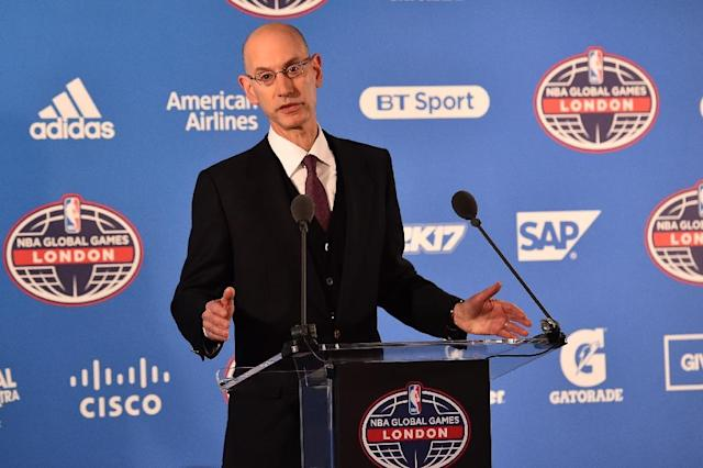 NBA commissioner Adam Silver, seen January 12, 2017, and players' union representative Michele Roberts first hammered out the league's new collective bargaining agreement (AFP Photo/Glyn KIRK)