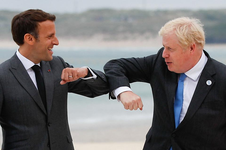 Boris Johnson greets French president Emmanuel Macron at the G7 summit on Friday (Photo: PHIL NOBLE via Getty Images)