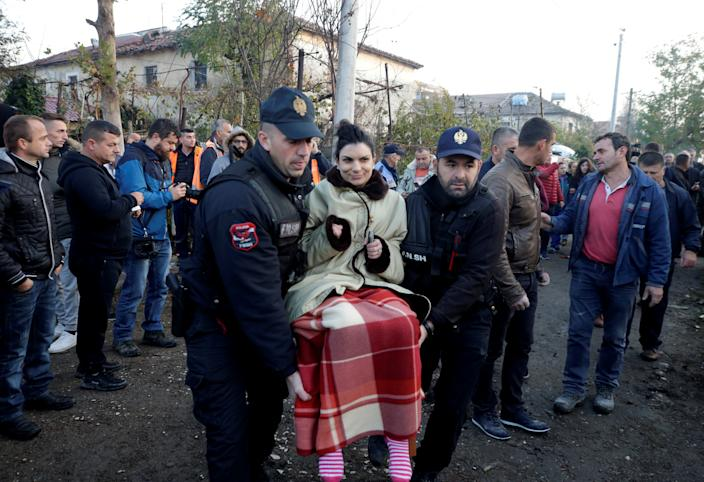 Emergency workers carry a women in Thumane, after an earthquake shook Albania, November 26, 2019. (Photo: Florion Goga/Reuters)