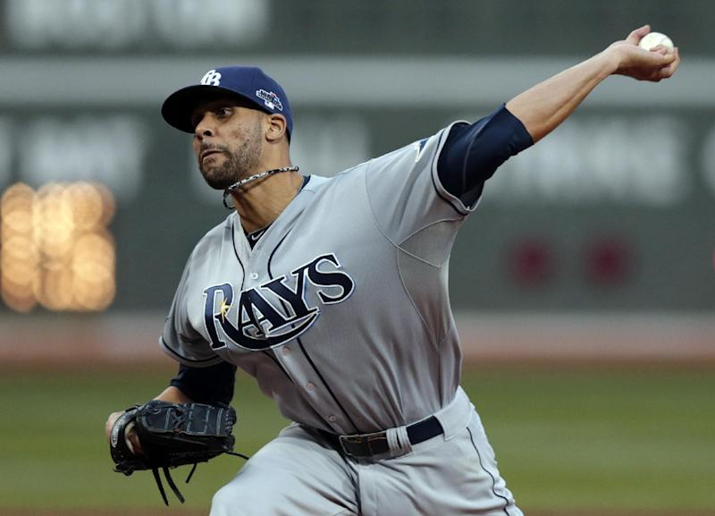 FILE - In this Oct. 5, 2013, file photo, Tampa Bay Rays starting pitcher David Price delivers against the Boston Red Sox during the first inning of Game 2 of baseball's American League division series in Boston. The three-time AL All-Star and the Rays have agreed to a $14 million, one-year contract, the highest single-season salary in franchise history. (AP Photo/Charles Krupa, File)