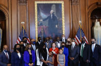 House Speaker Nancy Pelosi, D- Calif., speaks to reporters while standing with members of the Floyd family prior to a meeting to mark the anniversary of the death of George Floyd, Tuesday, May 25, 2021 at the Capitol in Washington. (Erin Scott/Pool via AP)