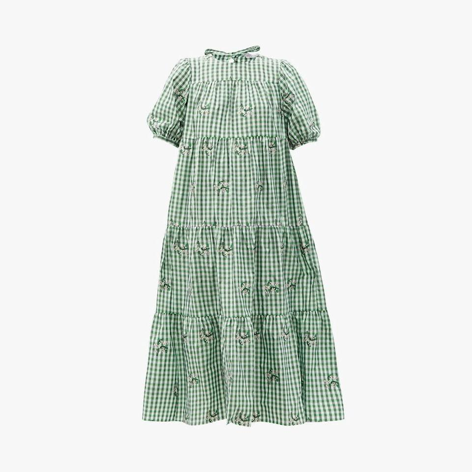 "$1075, MATCHESFASHION.COM. <a href=""https://www.matchesfashion.com/us/products/REDValentino-May-Lily-embroidered-gingham-taffeta-dress-1395913"" rel=""nofollow noopener"" target=""_blank"" data-ylk=""slk:Get it now!"" class=""link rapid-noclick-resp"">Get it now!</a>"