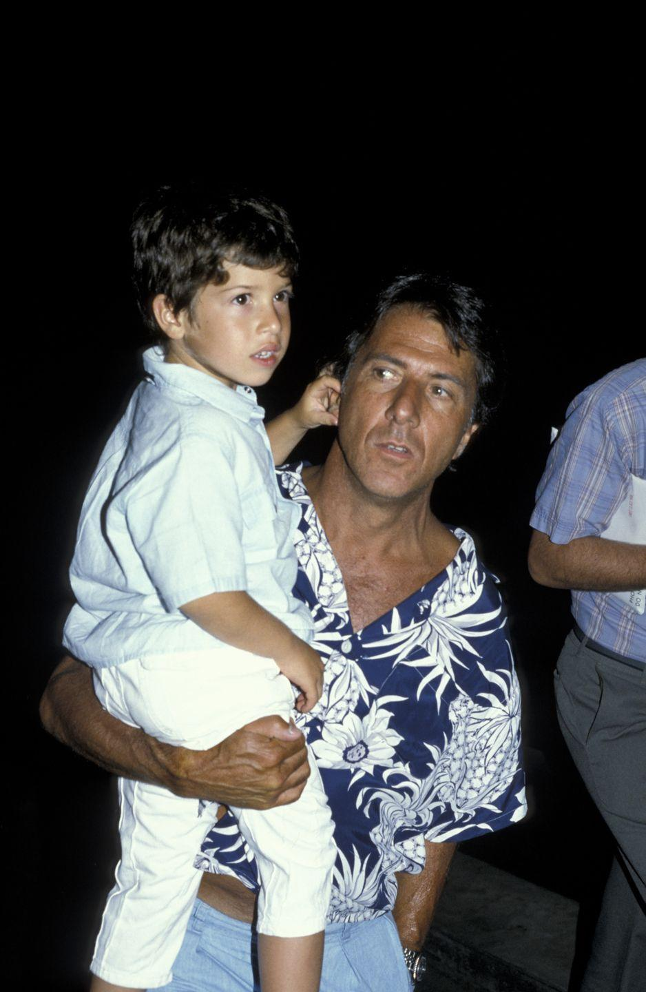 <p>Dustin Hoffman proves that the '80s were a great time for the chest hair trend. The actor showed his off in a patterned Hawaiian shirt, while carrying his son.</p>